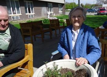residents enjoying plants together