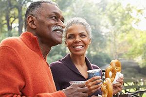 couple enjoying a pretzel together