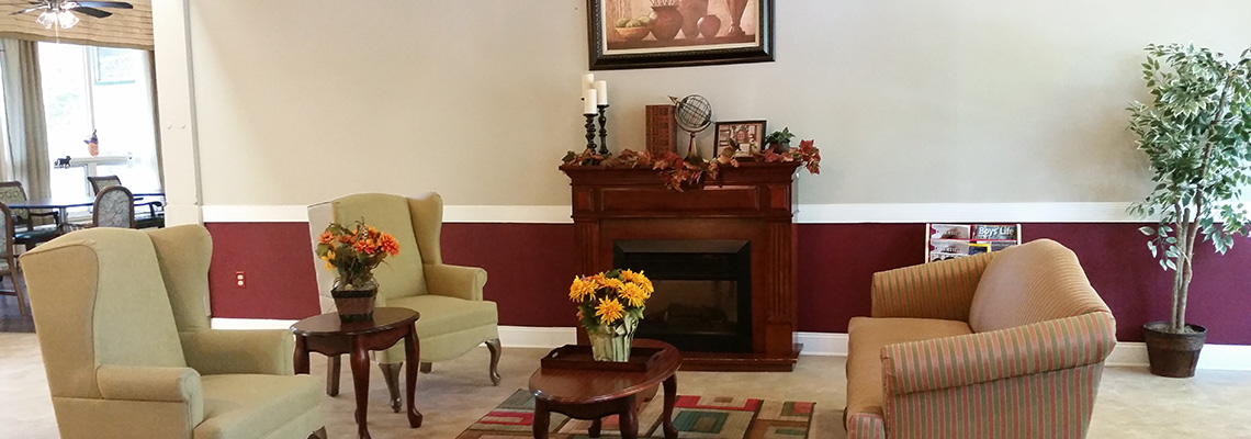 Eagleview front lobby with fresh flowers on every table and a fireplace