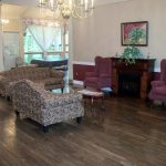 Eagleview Rehab front lobby with upholstered sofas and chairs and a fireplace