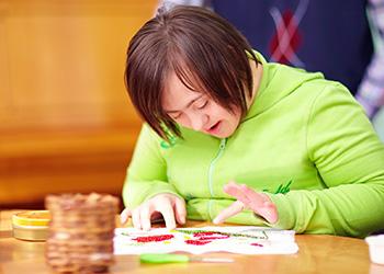 teen girl doing bead work