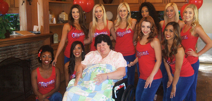 Clippers cheerleaders with a resident on a scheduled visit day
