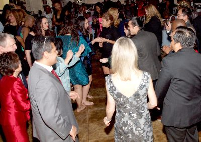 Staff dancing together at the holiday party