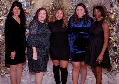 Staff standing together at the holiday party