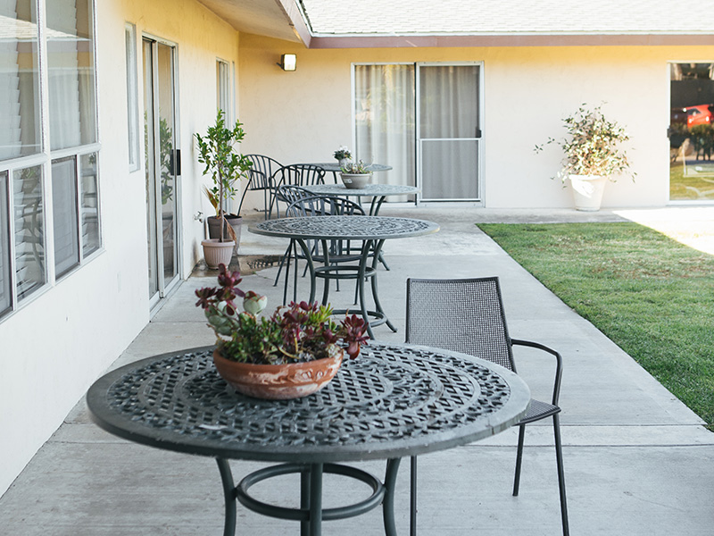 Outside seating and tables for relaxing in the shade of the afternoon or the morning sun.
