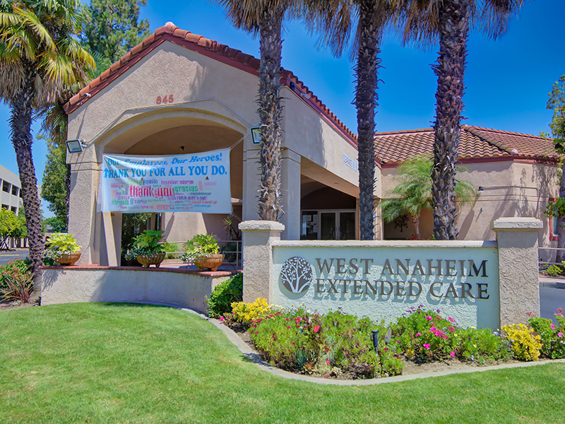 West Anaheim Extended Care Entrance with grass out front and a sign for the employees Thanking them for all they do!