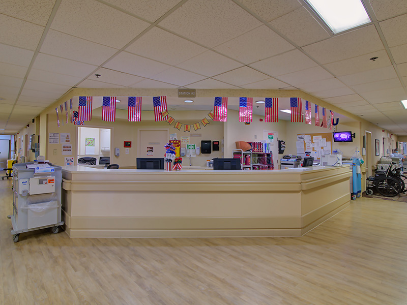 Nurses station with American flags hanging above it.