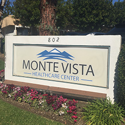 Monte Vista Healthcare Center wooden exterior sign