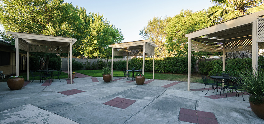Large, outside patio area with covered seating
