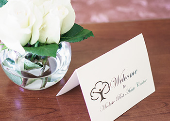 Welcome to Modesto Post Acute Center card and flowers