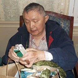 resident opening up a gift