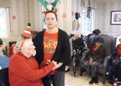 A resident with a holiday hat on.