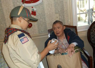 Residents opening gifts.