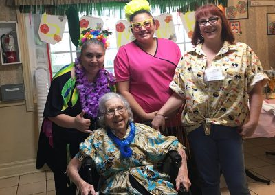 Residents enjoying a Hawaiian themed party.