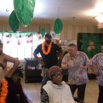 Residents and staff trying to dance