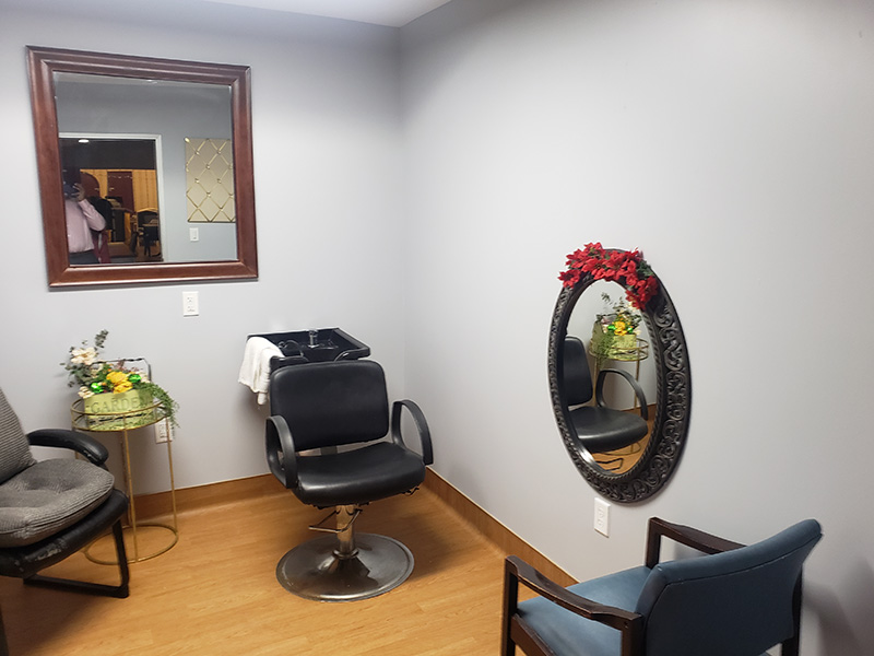 Resident salon with clean wood floors.