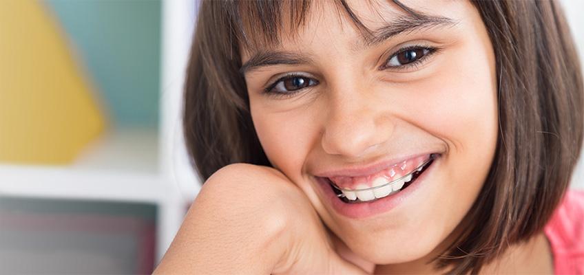 girl smiling wearing her retainer