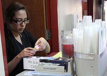 nurse organizing medicine