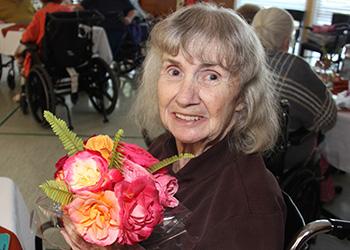 resident holding flowers