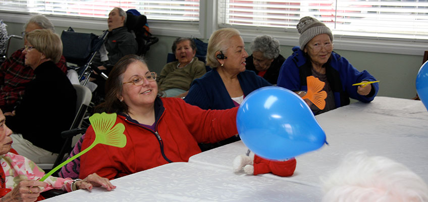 Residents playing a game with balloons all together