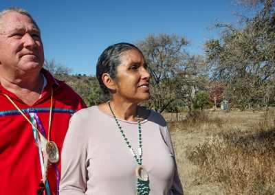 Gigi Nieblas and Jerry Nieblas walking on a portion of their ancient, ancestral land. Once the site of the sacred, pre-mission village of Putuidem. A section of this land will be developed into a cultural and educational Juaneno park that will be a living historical resource for visitors and school children.