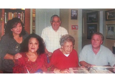 CHAC Board Members in action doing historical research with two historical family members. Standing, Missy Garcia, Babe Ramos (deceased), Left to right seated, Nollie Garcia, Helen Charles-McMullen (Matriarch of SJC), and Jerry Nieblas (CHAC President and Historian) Doing historical photo research. All these individuals have deep and rich historical ties to San Juan Capistrano and its history.