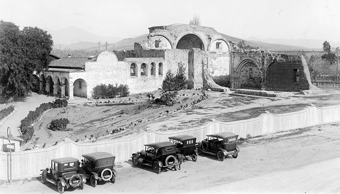 old cars in front of the mission