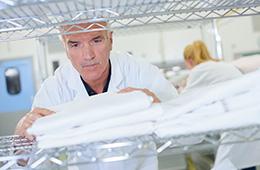 A man folding clean towels