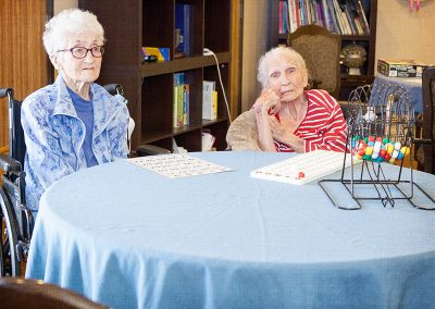 Two residents playing bingo.