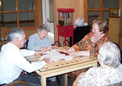 Residents playing a game of dominoes together