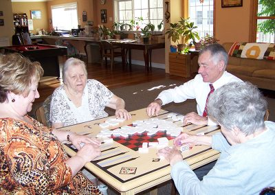 Residents playing dominoes together