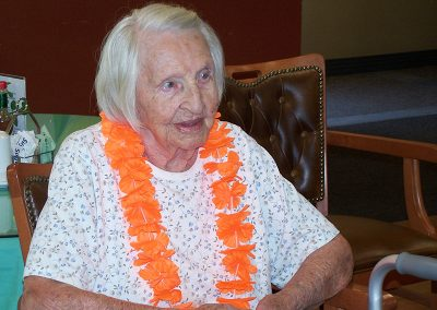 female resident wearing a lei for a luau party