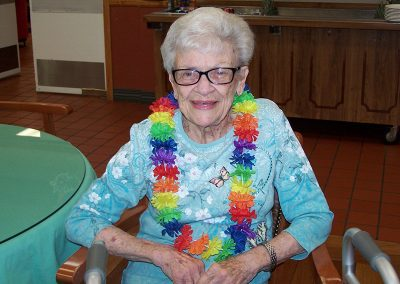 pretty elderly lady at the luau wearing a colorful lei