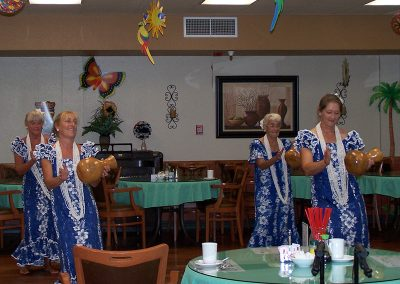 professional luau dancers wearing matching dresses