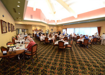 large dining room with residents eating