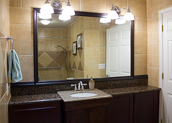 Renovated bathroom with beautiful counters, fixtures and shower