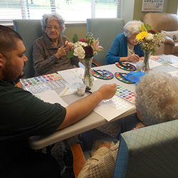 Residents painting together.