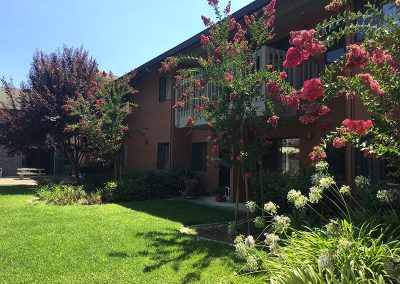 Resident apartment building with blooming flowers out front