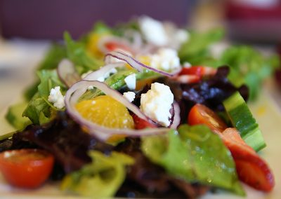 Vibrant salad with crumbled cheese and purple onion