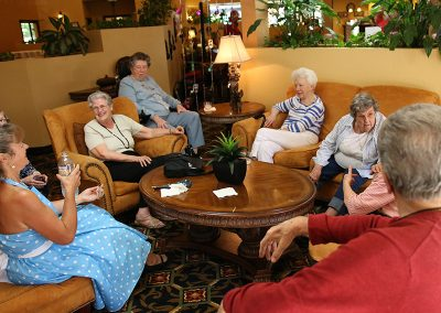 Residents sitting in the lounge area laughing and talking