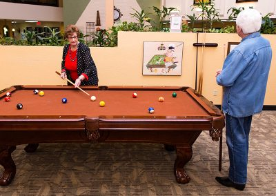 Two residents playing a game of pool