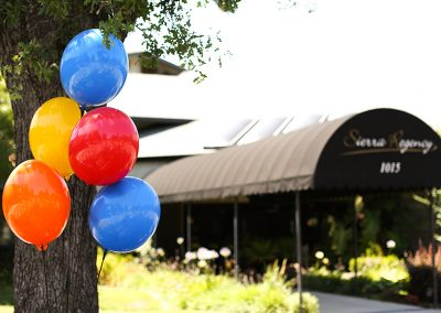 Sierra Regency entrance with balloons out front