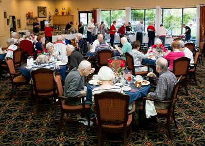 Residents eating in the main dining room
