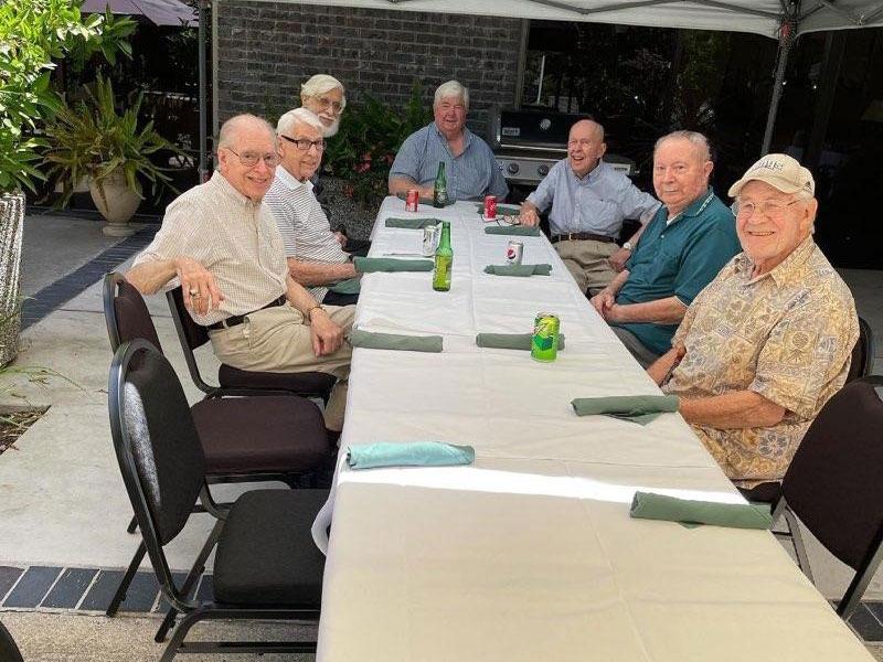 Sierra Regency residents enjoying conversation outdoors