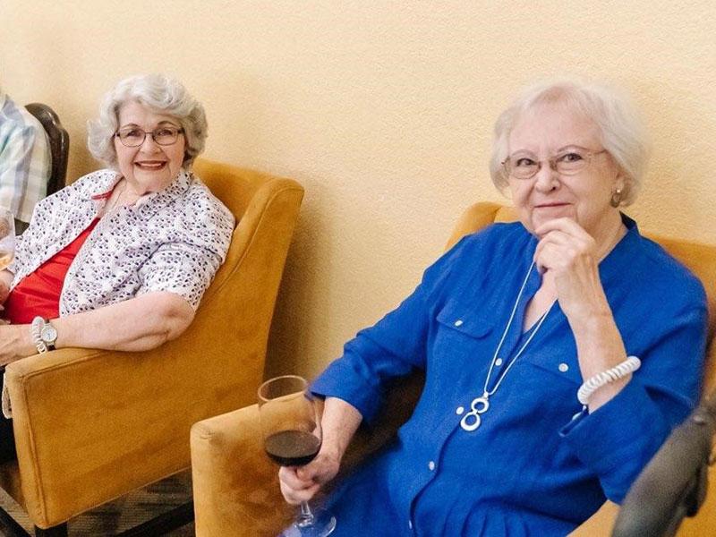Sierra Regency residents enjoying conversation and wine