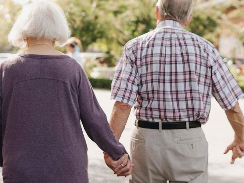 Sierra Regency couple holding hands