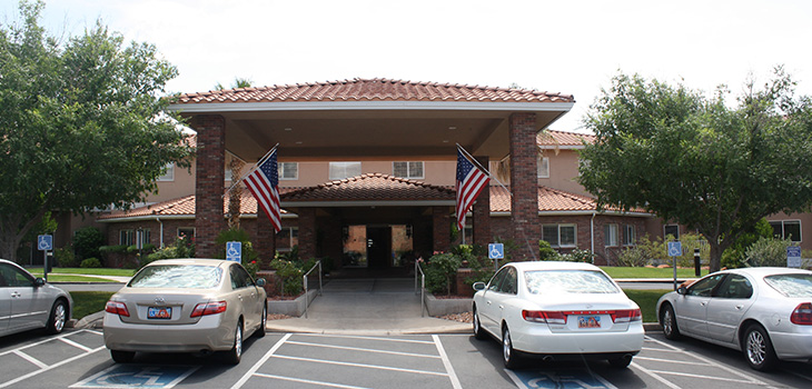 Entrance of the building with American flags hanging