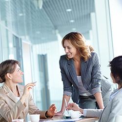 three women talking in a business meeting