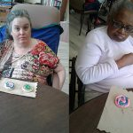 Two residents with their decorated cookies.