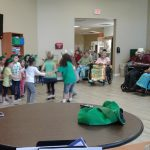 Children performing for residents.